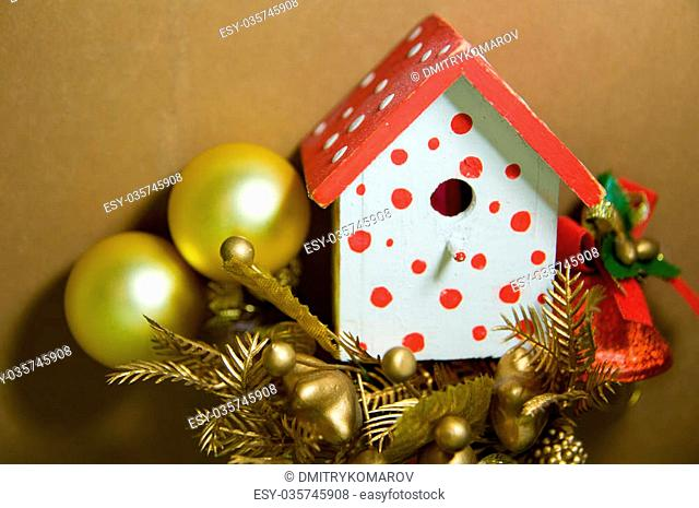 Bird House Christmas-Tree Decorations on a Brown Background with Christmas Balls, Christmas Bell and other Decorations