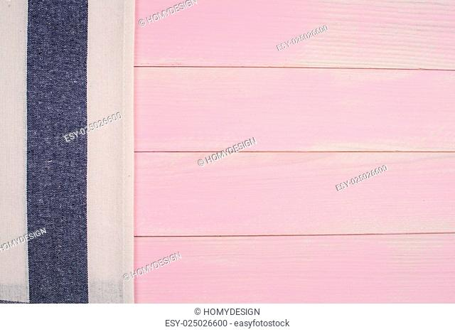 Blue striped towel over the surface of a wooden table