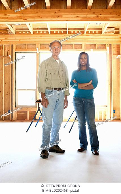 Construction workers standing in unfinished room
