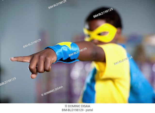 African American boy playing in superhero costume