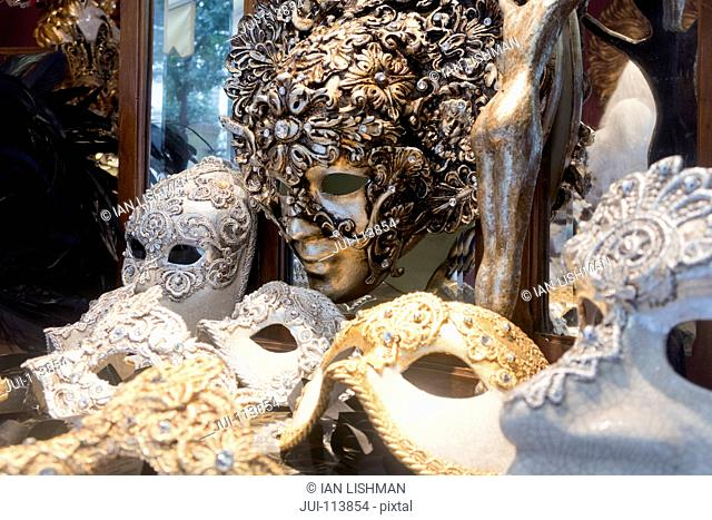 Variety of ornate Venetian masks for Venice Carnival on display in shop, Italy
