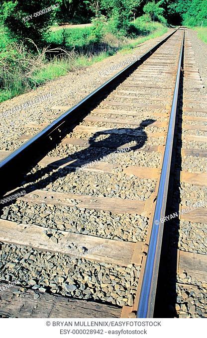 Shadow on railroad track. Benton County. Oregon. USA