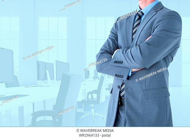 Businessman crossing his hands in office