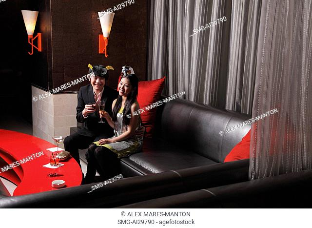 Young couple sitting together at a club