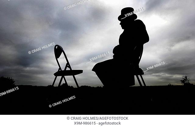 Undertaker sitting on a chair