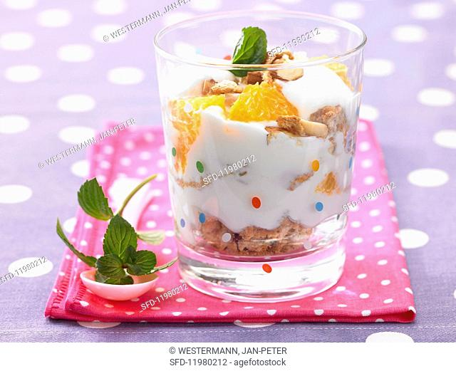 Orange cream with honey and roasted nuts