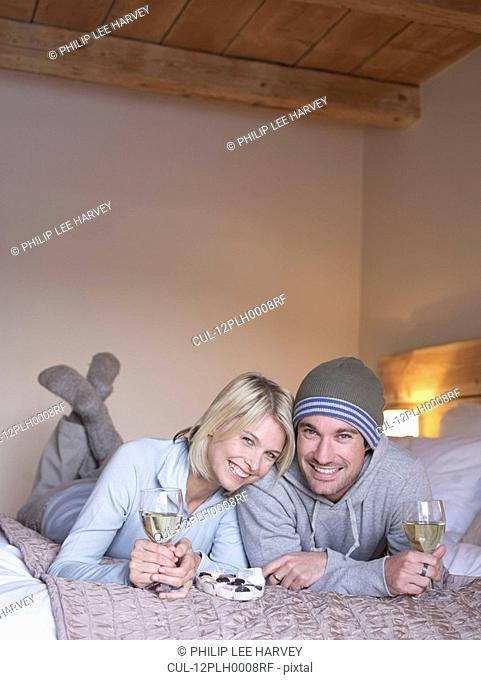 woman and man lying smiling at viewer