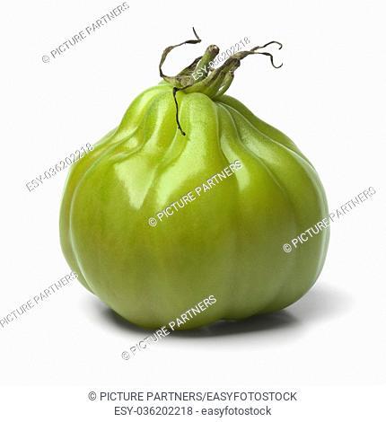 Single green Coeur de boeuf tomato on white background