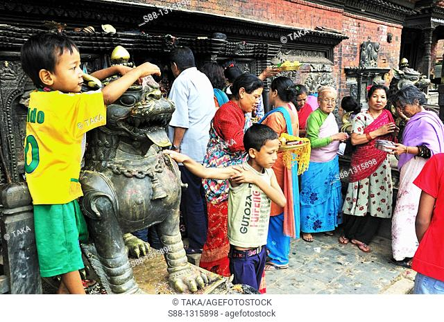 Bhairabnath temple at heart of the town Taumadhi Tol Square, all day long people come and pray for God