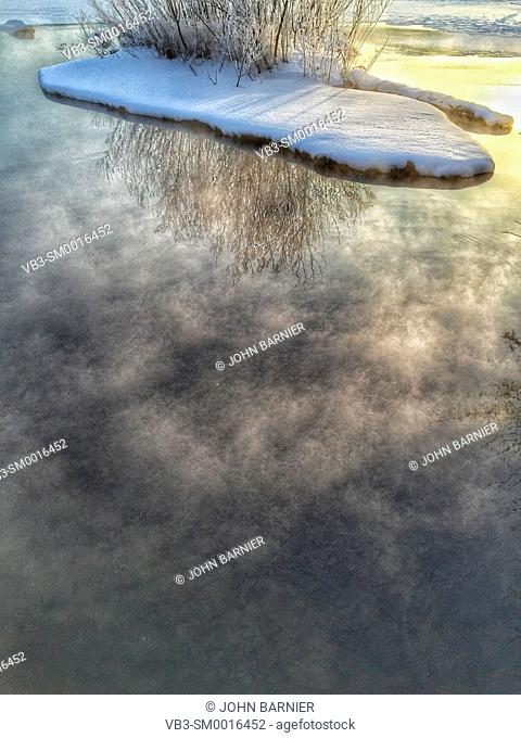 Steam rising from Lake Harriet in Minneapolis, Minnesota USA on a very cold winter morning
