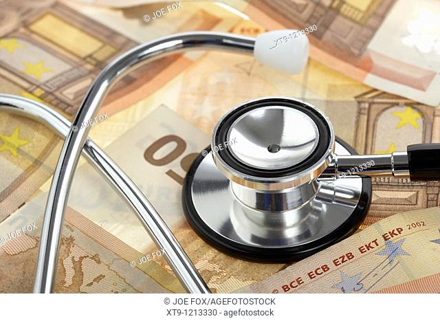 medical stethoscope on a pile of fifty euro banknotes