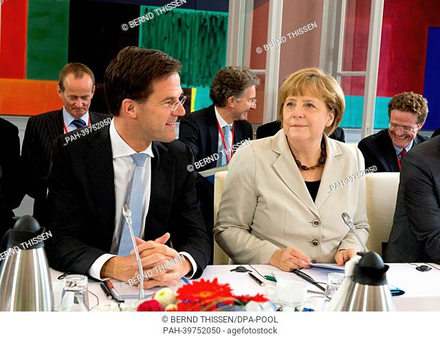 German Chancellor Angela Merkel and Dutch Prime Minister Mark Rutte take part in the first German-DutchCabinet Meeting at the Kurhaus Museum in Kleve, Germany