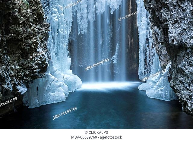 Italy, trentino south Tyrol, Non Valley, Waterfall from Smeraldo lake in winter