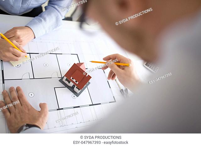 close up of architects discussing house project