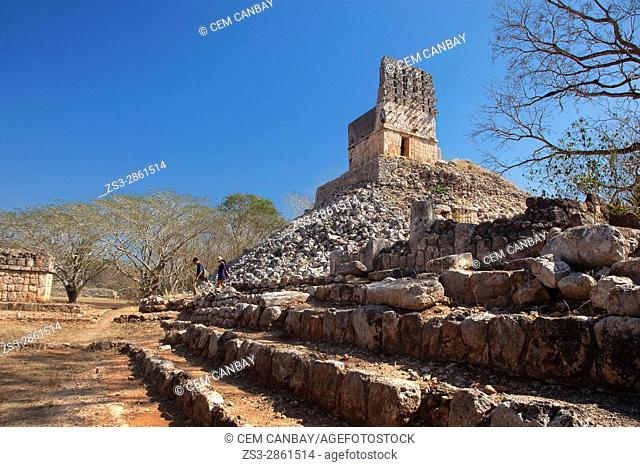 Visitors near the El Mirador-Observatory in the Labna Archaeological site, Puuc Route, Merida, Yucatan State, Mexico, Central America