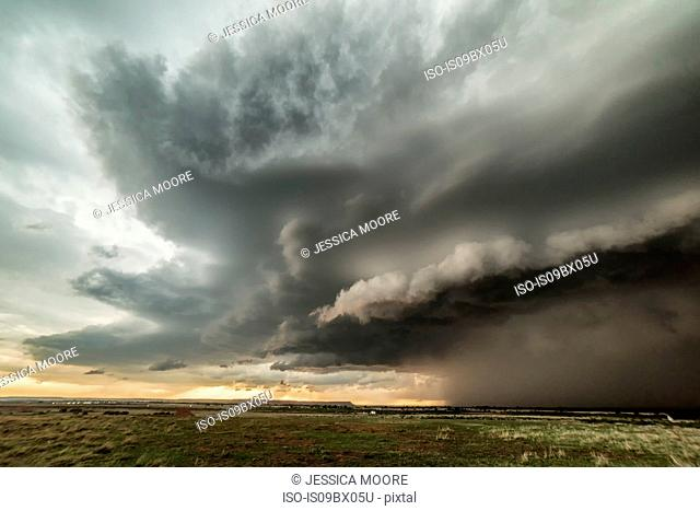 Tornadic supercell in western Oklahoma creates a dramatic landscape scene. Massive hail and small tornado during storm, USA