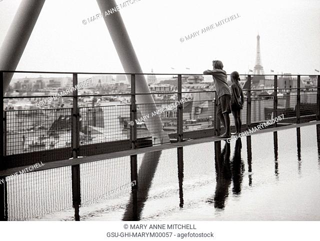 Two Children Looking at Cityscape from Pompidou Museum with Eiffel Tower in Background, Paris France