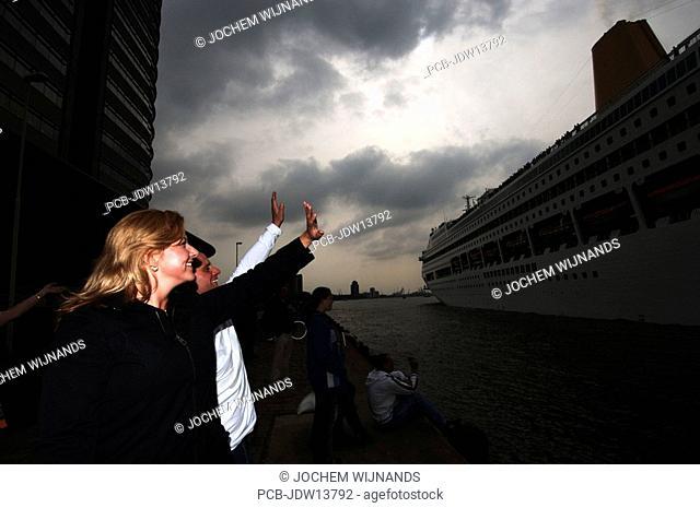 Port of Rotterdam, Kop van Zuid, waving a cruise ship from the Holland Amerika lijn goodbye