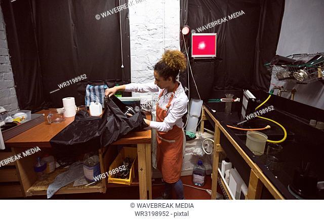 Female photographer working in photo studio