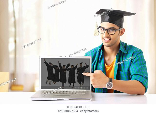 Young Man Pointing At Laptop