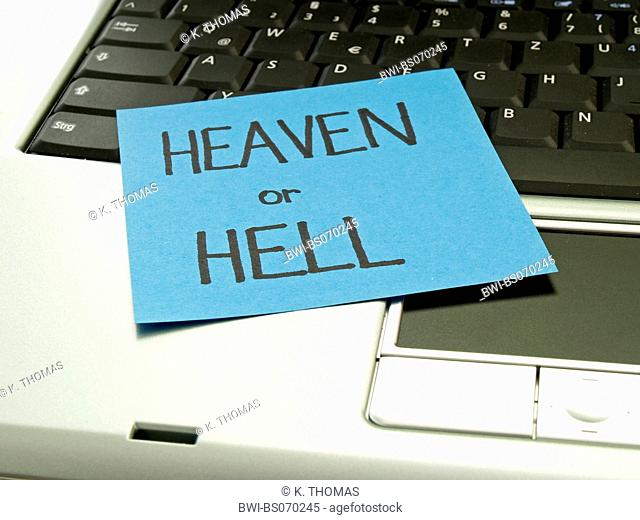 memo note on notebook, heaven or hell