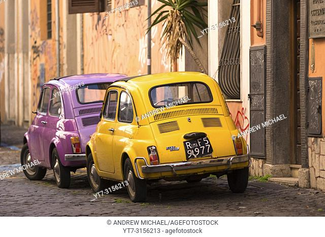 Two classic Fiat 500 cars parked on Trastevere backstreet, Rome, Lazio, Italy