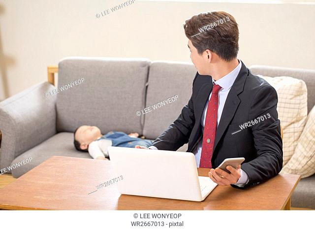 Businessman taking care of his baby