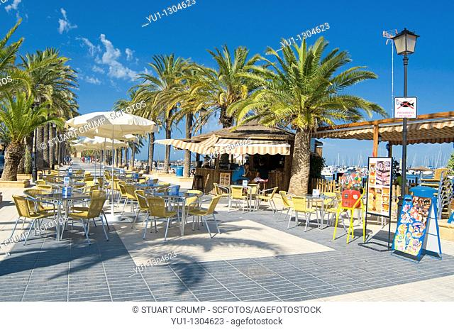 Cafe table and chairs on the sea front Promenade at Los Alcazares, Murcia, Spain