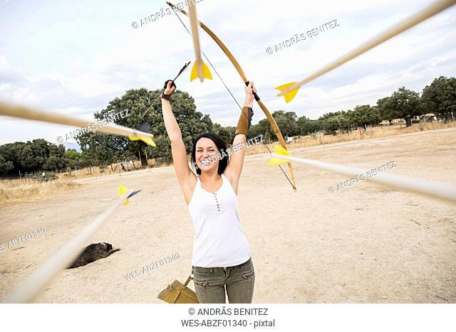 Happy archeress on sports field