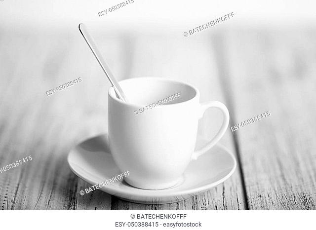 white coffe cup on light wooden table