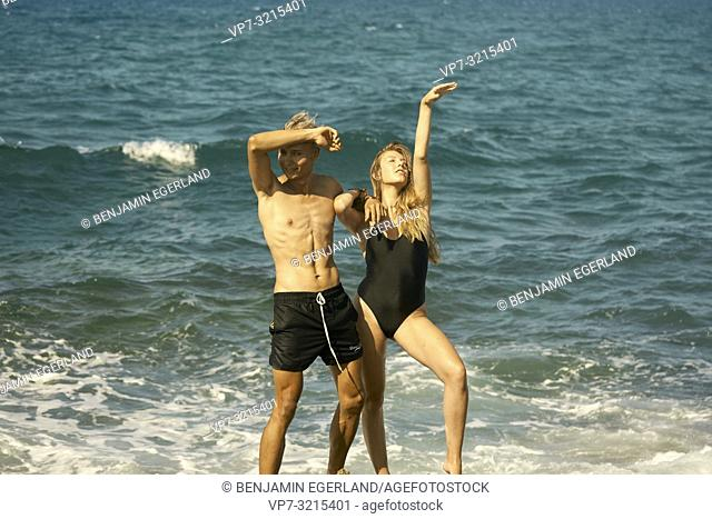 young couple together at seaside enjoying summer holiday in Crete, Greece