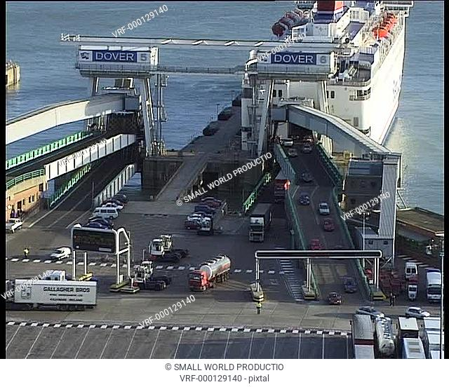 Cars and lorries leaving ferry in port. Dover, U.K