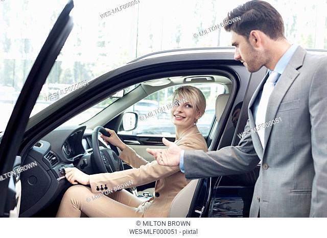 At the car dealer, Couple at new car