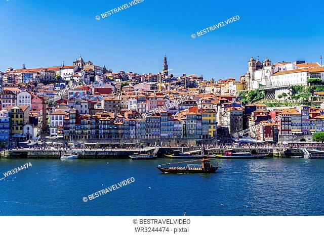 Boats on the Douro River and traditional houses of Ribeira District seen from Vila Nova de Gaia district, Porto, Portugal, Europe