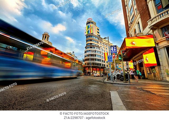 Traffic and luminous signs at Gran Via street at the intersection with Callao square. Madrid. Spain