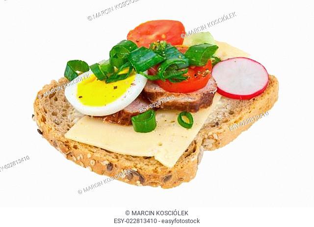 Sandwich with cheese, egg, tomato, radish
