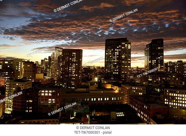 Dramatic sky over city at dusk