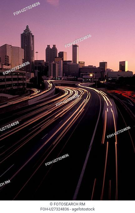 expressway, skyline, Atlanta, GA, Georgia, Skyline of downtown Atlanta and streaks of car lights on I-75/I-85 connector at sunset