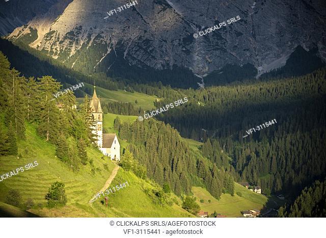 La Valle / Wengen, Alta Badia, Bolzano province, South Tyrol, Italy. The St. Barbara chapel at sunset