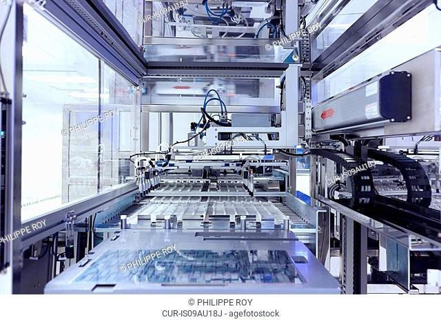 Manufacturing machine in flexible electronics factory clean room