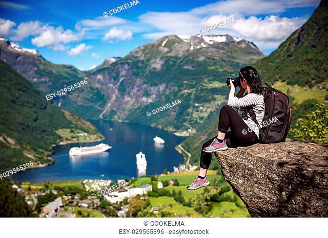 Geiranger fjord, Beautiful Nature Norway panorama. Nature photographer tourist with camera shoots