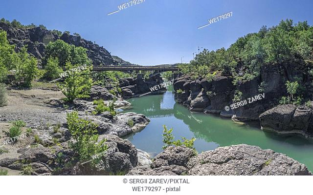 Venetikos river with green water and beautiful rock formations near Meteora in Greece