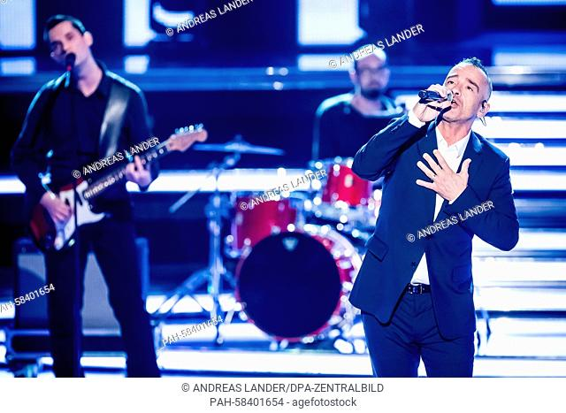 A picture made available on 17 May 2015 of Italian singer Eros Ramazzotti performing on stage with dancers at German TV show 'Willkommen bei Carmen Nebel' in...