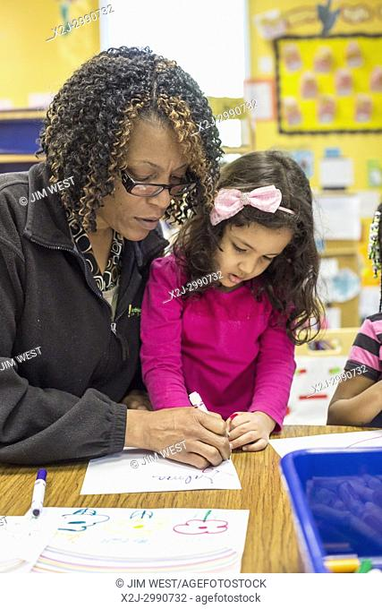 Charlotte, North Carolina - A teacher works with a girl in Head Start at the Bethlehem Center. The Center serves low-income families in Charlotte; it is...