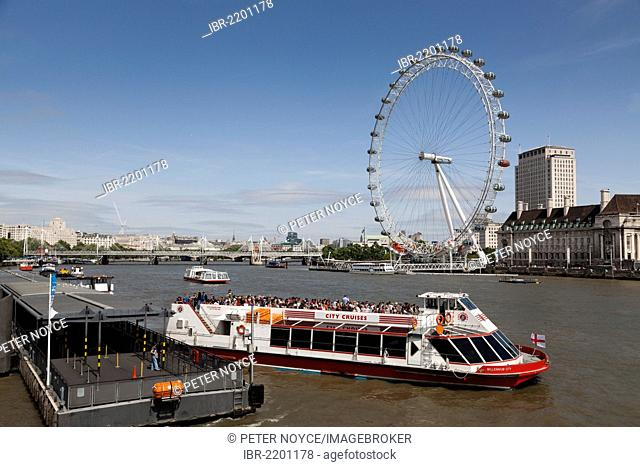London Eye and a river cruiser on the River Thames, London, England, United Kingdom, Europe