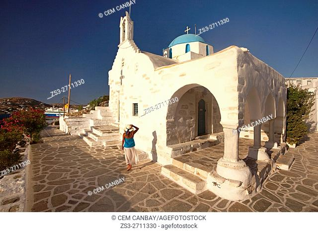 Woman in front of the blue domed main church in Parikia, Paros, Cyclades Islands, Greek Islands, Greece, Europe