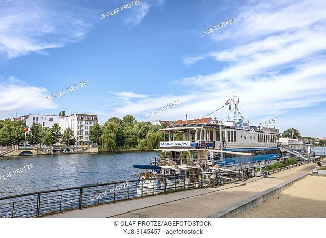 Riverside hostel ships next to Eastside Gallery Berlin, Kreuzberg, Germany