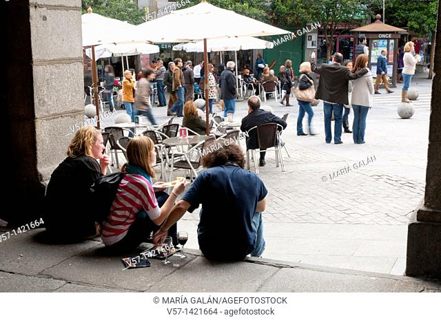 Young people having lunch in the street. Ciudad Rodrigo street, Madrid, Spain