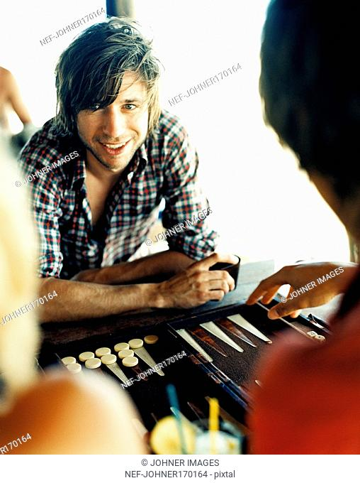 A man playing backgammon