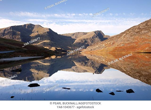 Ogwen Valley Gwynedd North Wales UK Europe  November Still water of Llyn Ogwen lake reflecting Y Garn and Foel Goch mountains in Snowdonia National Park